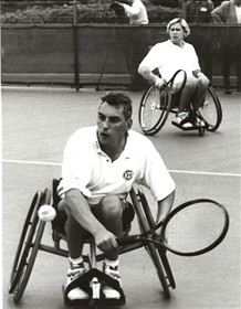 Photo:Peter Norfolk at the Japanese Open using an early three-wheel chair, ca 1998