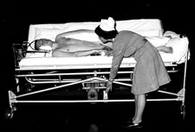 Photo:Nurse turning a patient.