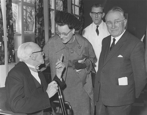 Photo:Ludwig Guttmann and Lady Hamilton Smith at theopening of the Rehabilitation Hostel at Stoke Mandeville in 1970. Jimmy Brennan who was to manage the unit with his wife Mary is standing behind.