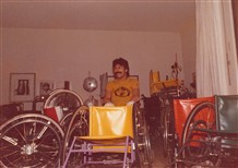 Photo:Rainer Küschall with his first large commercial order for 27 wheelchairs, awaiting delivery to Kuwait from his living room, ca 1980