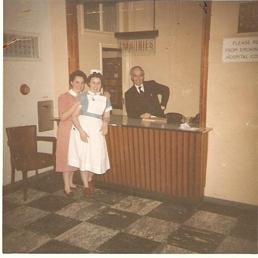 Photo:Head Porter, Tommy Ounsworth and unidentified nurse at the hospital reception, ca 1960