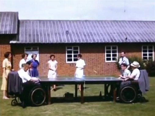 Photo:Table tennis being played in summer outside the wards at Stoke Mandeville, 1955
