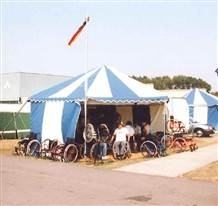 Photo:wheelchair repair tents, 1984